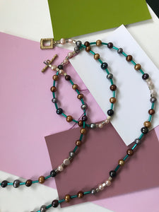 Beaded Necklace with Pearls and Metallic Turquoise Spacers.