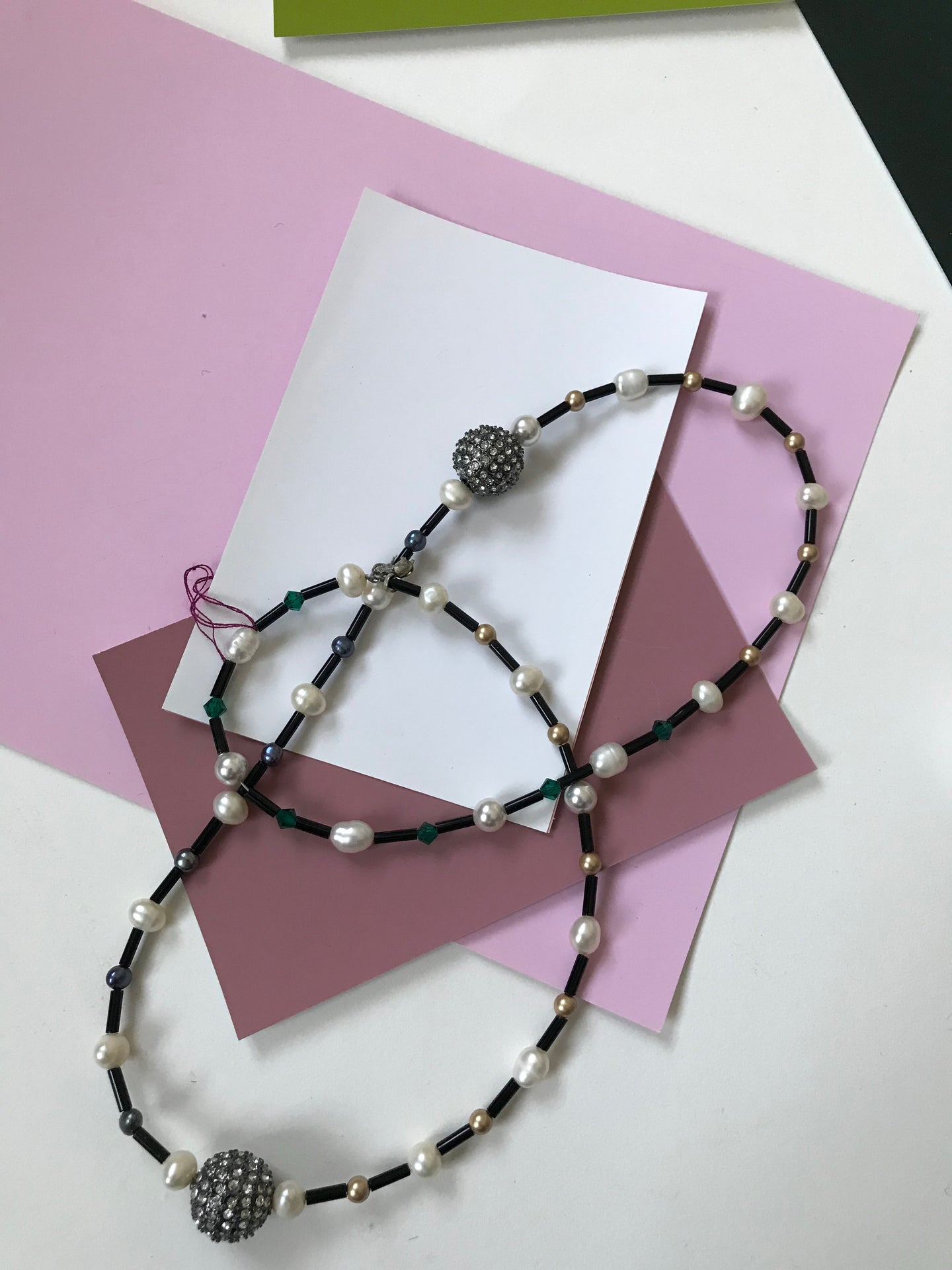 Necklace with alternating pattern of small freshwater pearls.
