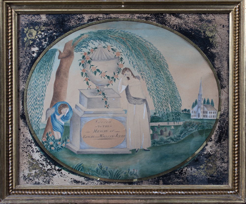 A MEMORIAL OF TWO FIGURES AND AN ANGEL STANDING BENEATH A WILLOW TREE IN A CEMETERY