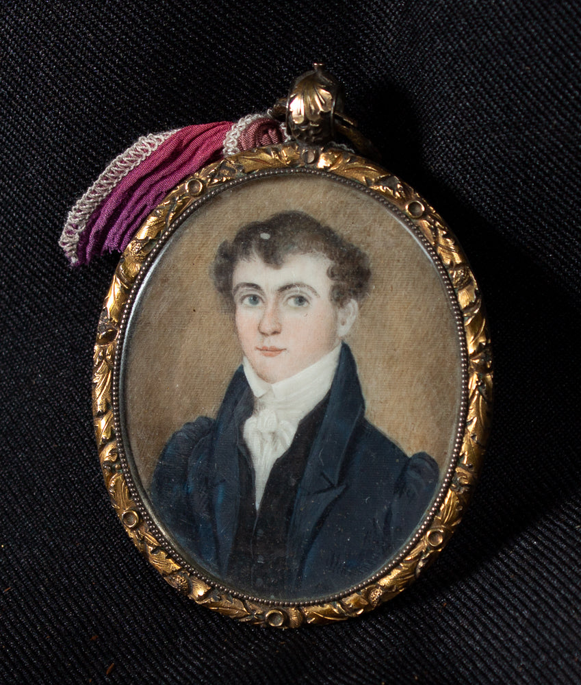 MINIATURE ON IVORY OF A YOUNG MAN