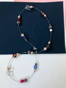 Necklace with clustered pearl, glass and metal beads