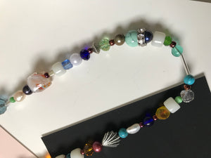Beaded necklace with wide variety of bead organization