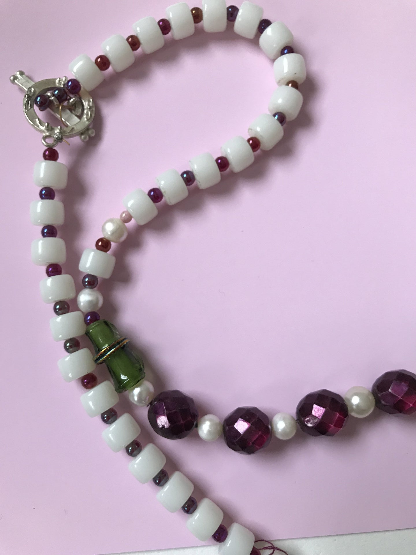 A two color, double patterned necklace