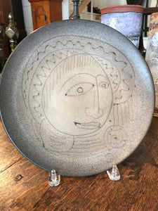 Tan Plate with Face by Edwin and Mary Scheier