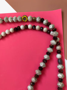 Beaded necklace with faceted white & iridescent beads