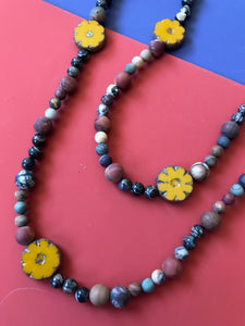 Dakota bead necklace with yellow ceramic flowers.