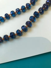 Load image into Gallery viewer, Faceted bead necklace with tied pumpkin- colored knots