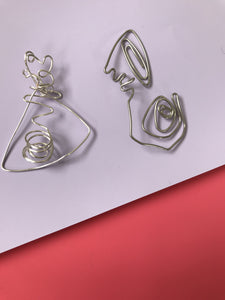 Two figurative silver earrings
