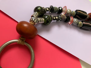 Beaded necklace with Ancient amber and antique Tibetan silver child's bracelet.
