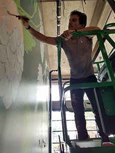 Sean Martorana in progress on a mural