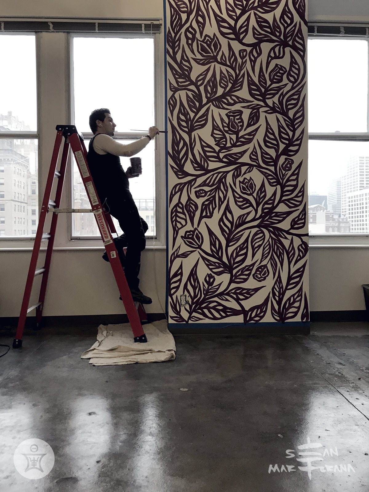 Sean Martorana painting and installing a Flourish Mural in Scribewise Philadelphia, PA