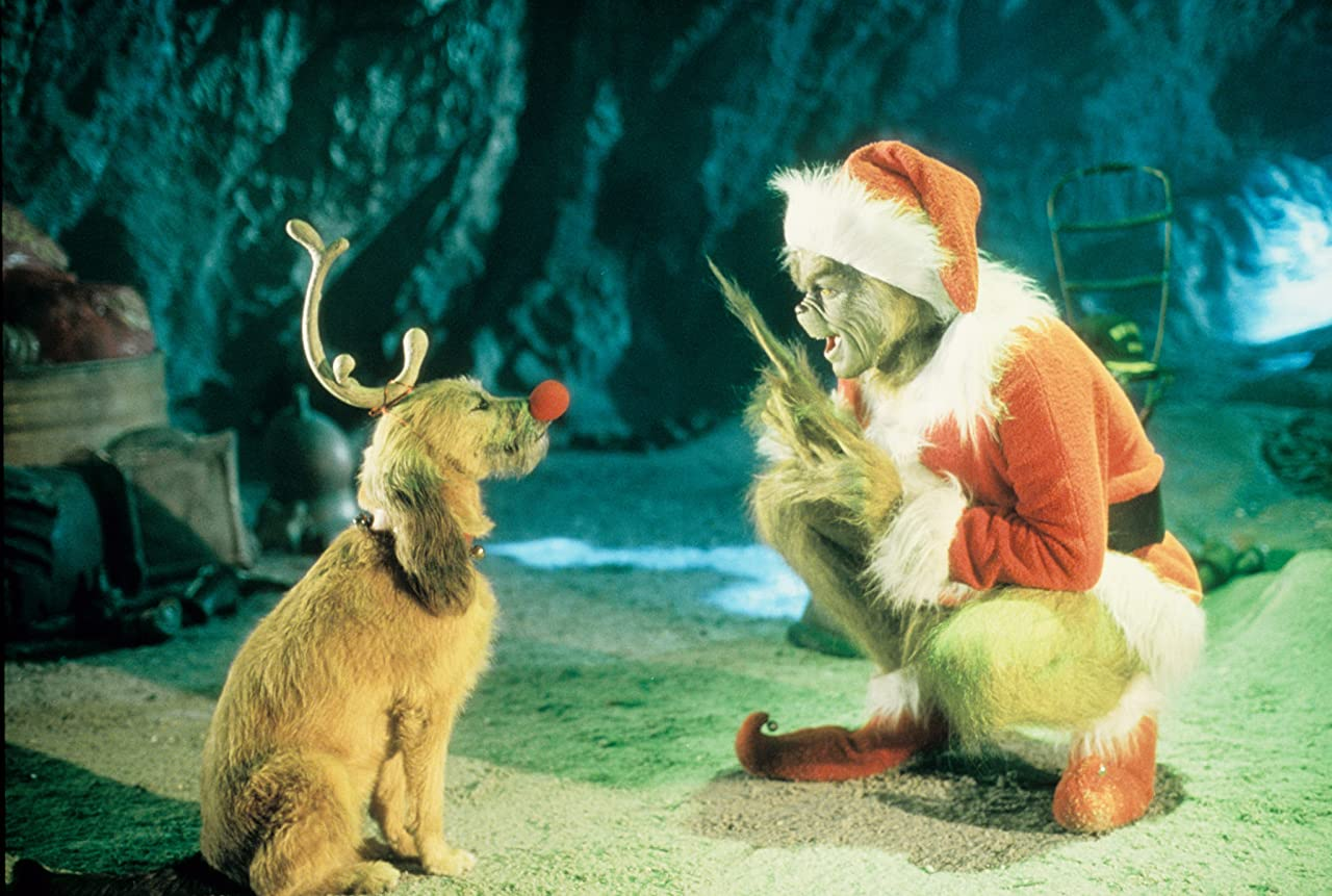 The grinch dressed as Santa with his dog Max dressed in reindeer antlers. From the film How The Grinch Stole Christmas.