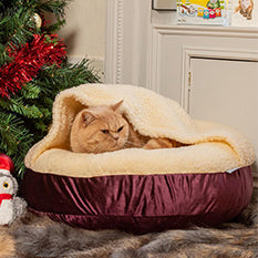 Cat snuggled into a Lords & Labradors Grape Velvet Cat Bed
