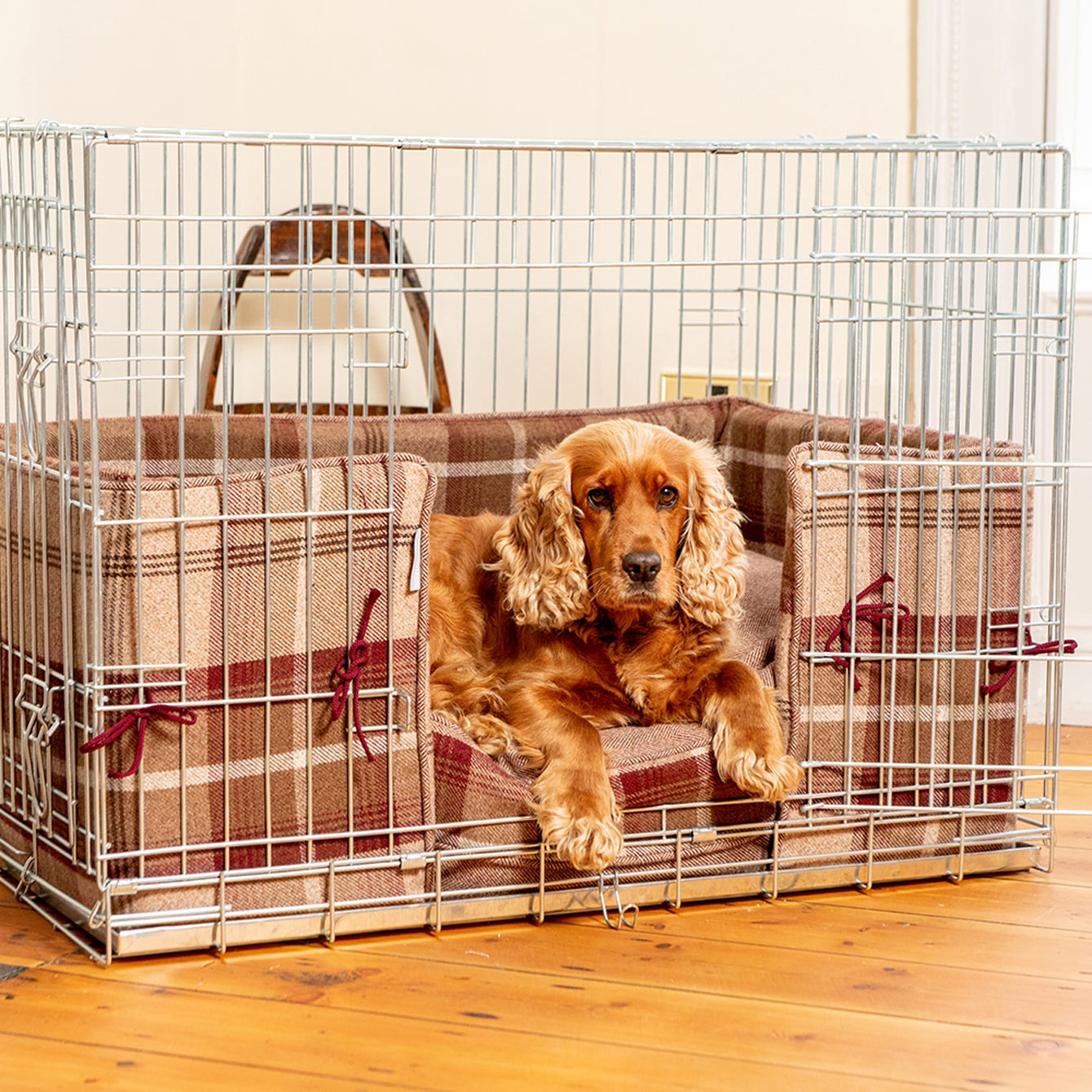Cocker spaniel sitting in dog crate with crate set bedding by Lords & Labradors