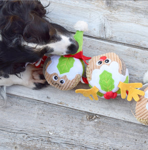 Spaniel playing with a Festive Three Puddings on a Rope Christmas Dog toy