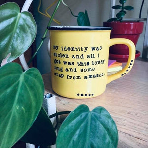 My identity was stolen and all I got was this lousy mug and some crap from amazon
