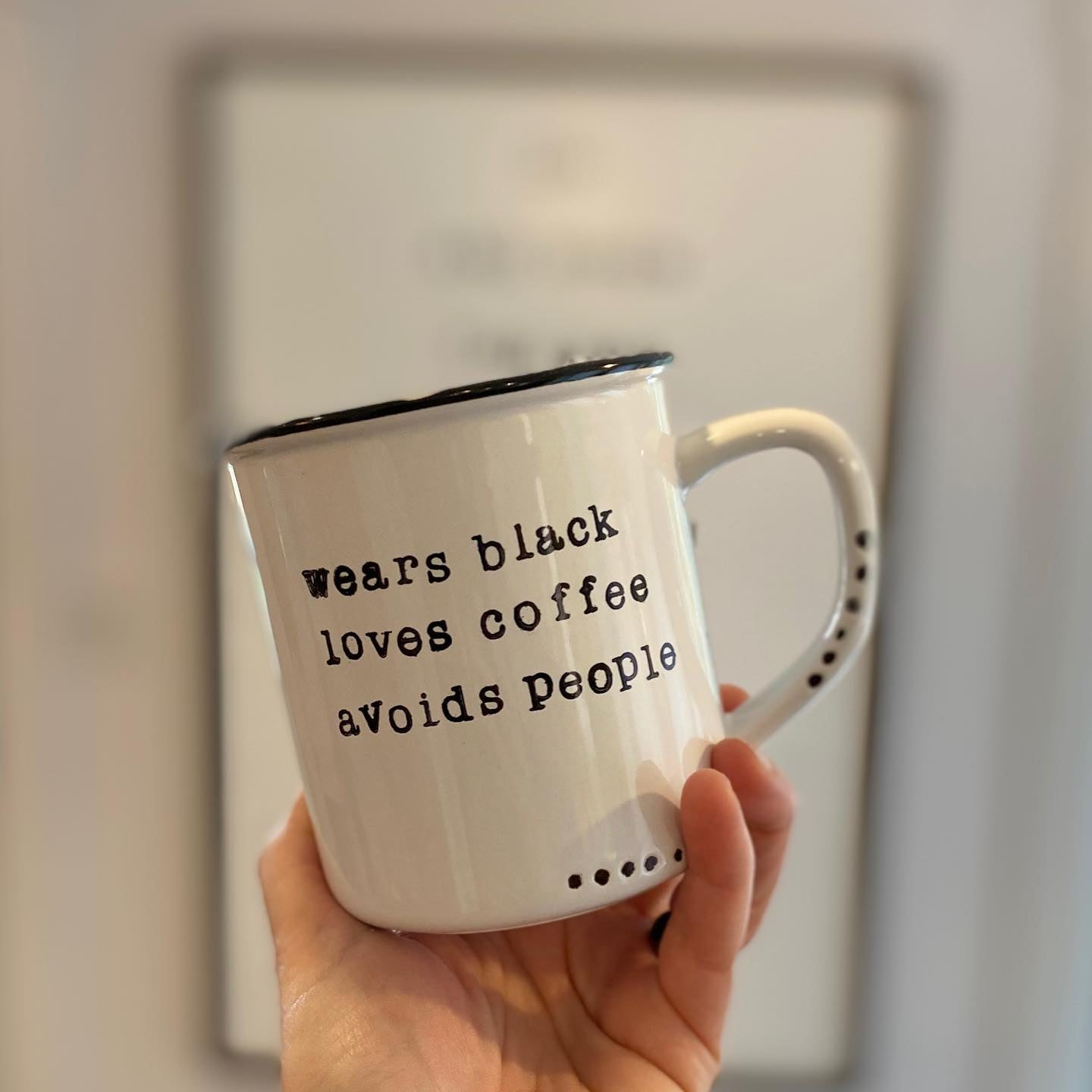 Wears black loves coffee avoids people