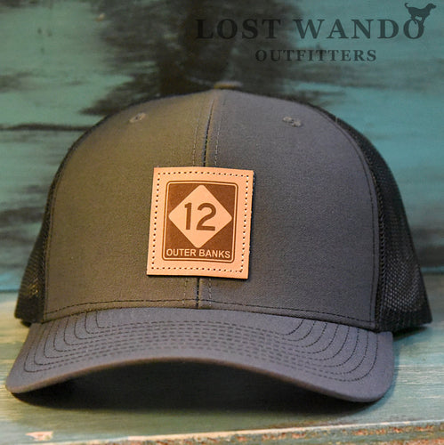 OBX-Highway 12 Leather Patch Trucker Hat- Charcoal -Black Richardson 112 Lost Wando Outfitters. Outer Banks Highway 12