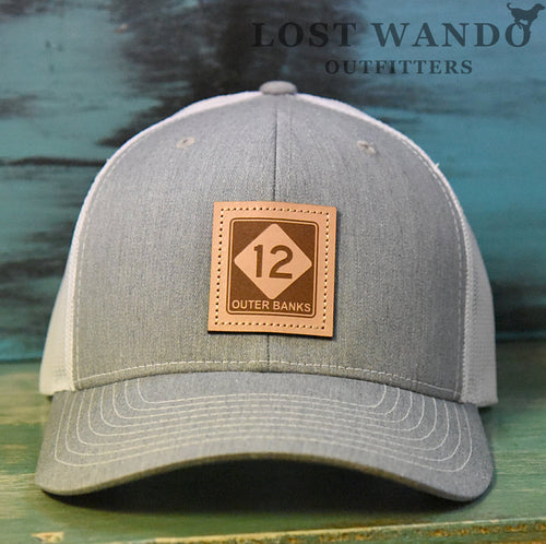 OBX-Highway 12 Leather Patch Trucker Hat- Heather Grey-White Richardson 112 Lost Wando Outfitters. Outer Banks Highway 12