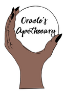 brown hand with black nails holding a crystal ball with oracles apothecary in the middle of the ball