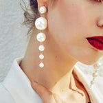SEXY AND ELEGANT BIG SIMULATED PEARL STRING STATEMENT LONG AND DROP EARRINGS