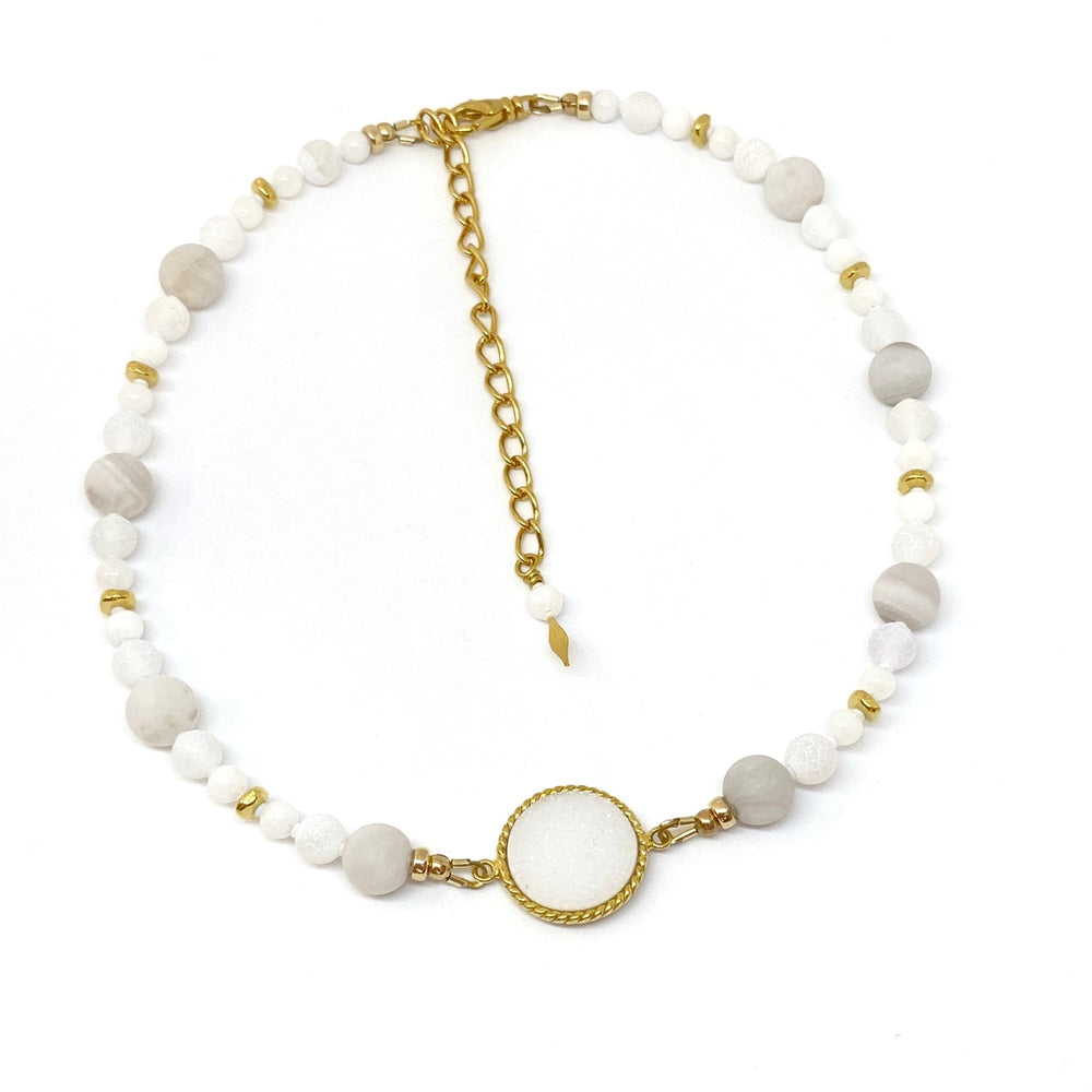 White Beaded Necklace with Golden Accents
