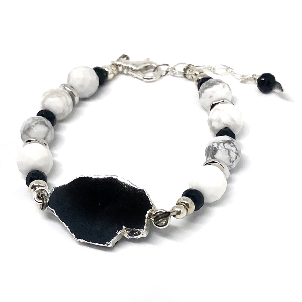 "Close-up of white howlite faceted beads, black Czech glass beads, and silver-plated spacers in ""Lake Moon"" bracelet from STARSNOW Collection"