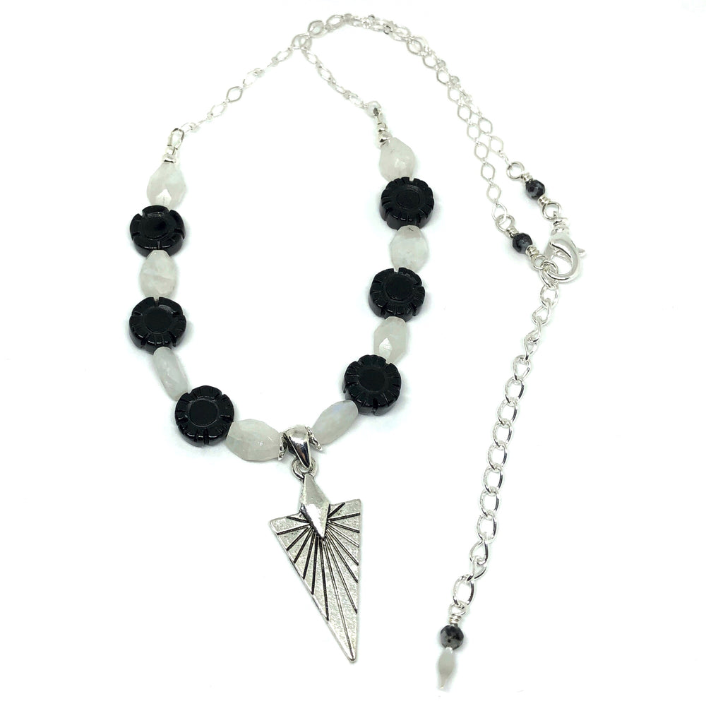 Black, White, and Silver-Toned Necklace with Arrowhead-Shaped Pendant