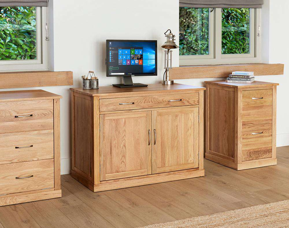 drawer open image of the baumhaus mobel oak desk height filing cabinet cor07a shown with other