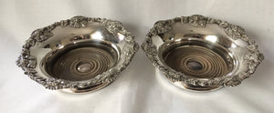 Victorian pair of silver plated bottle coasters with applied rims of trailing vines.
