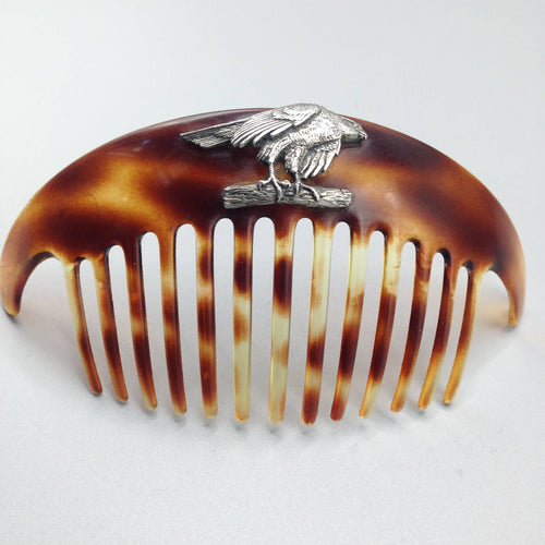 Large 1950's faux tortoiseshell hair comb with family crest