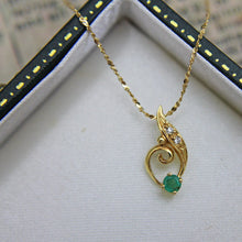 18ct Emerald & Diamond Pendant
