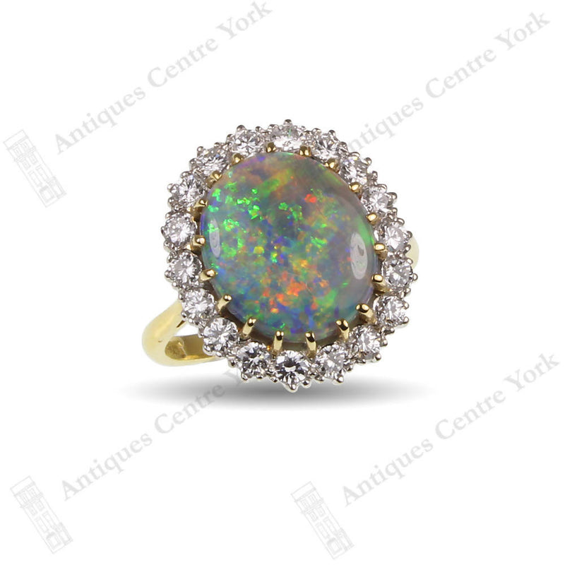 18ct Black Opal & Diamond Oval Cluster Ring