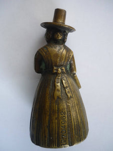 A Heavy Brass Bell Featuring a Lady in Traditional Dress.