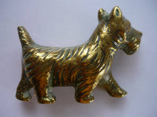 A Small but Heavy Brass Scottie Dog Ornament.