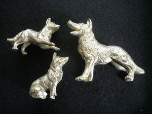 A Delightful White Metal Dog Family Group.