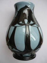 A Moorcroft Vase with a Design of Silhouetted Trees Against a Blue Ground.
