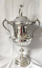 Large Victorian silver plated wrestling trophy cup and cover with ornate finial. Henry Bourne of Birmingham circa 1890.
