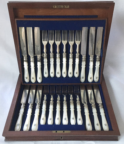 Victorian cased set of crested silver plate and mother of pearl dessert cutlery for twelve. Elkington 1880 and 1881.