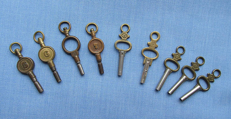 Collection Of Nine Numbered Watch Keys/Two Marked Switzerland