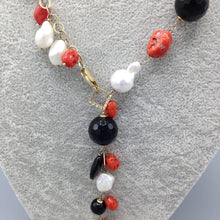 Silver gilt, red coral and baroque pearl necklace