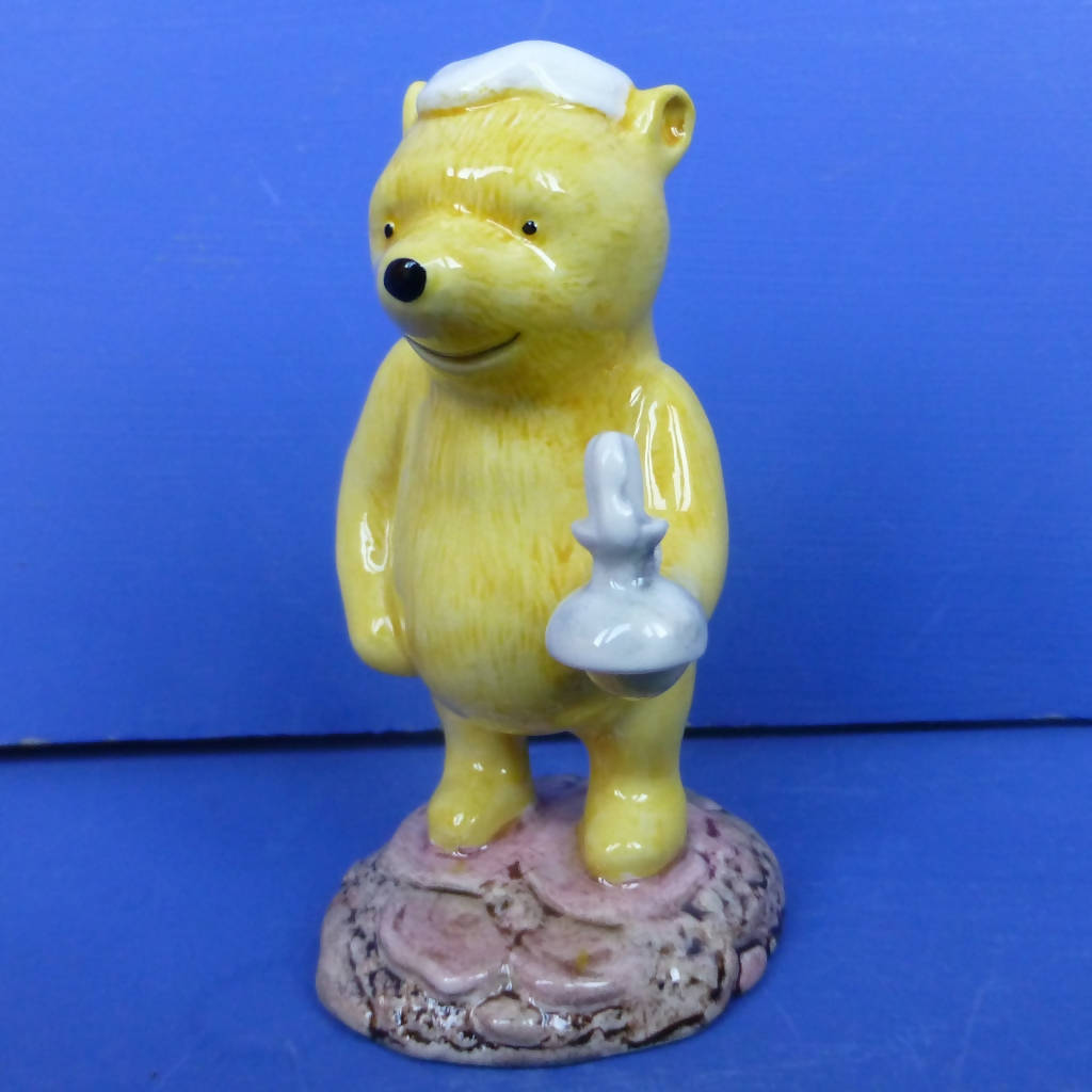 Royal Doulton Winnie the Pooh Figurine - Pooh Lights The Candle (Boxed)