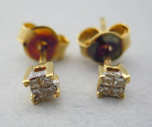 Diamond stud earrings set in 18ct gold
