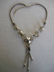 A 'Statement' Style Silver Tone Necklace.