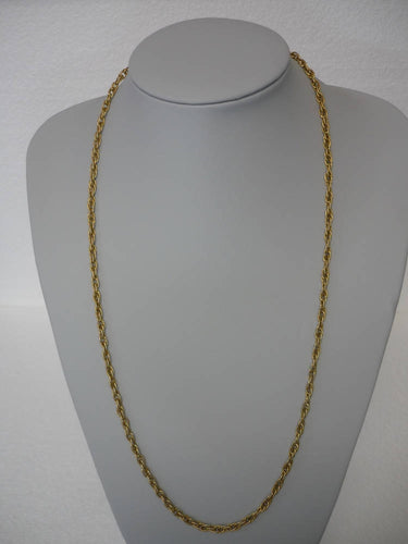 A Gold Tone Interlinked Chain Style Necklace Signed Monet ©.