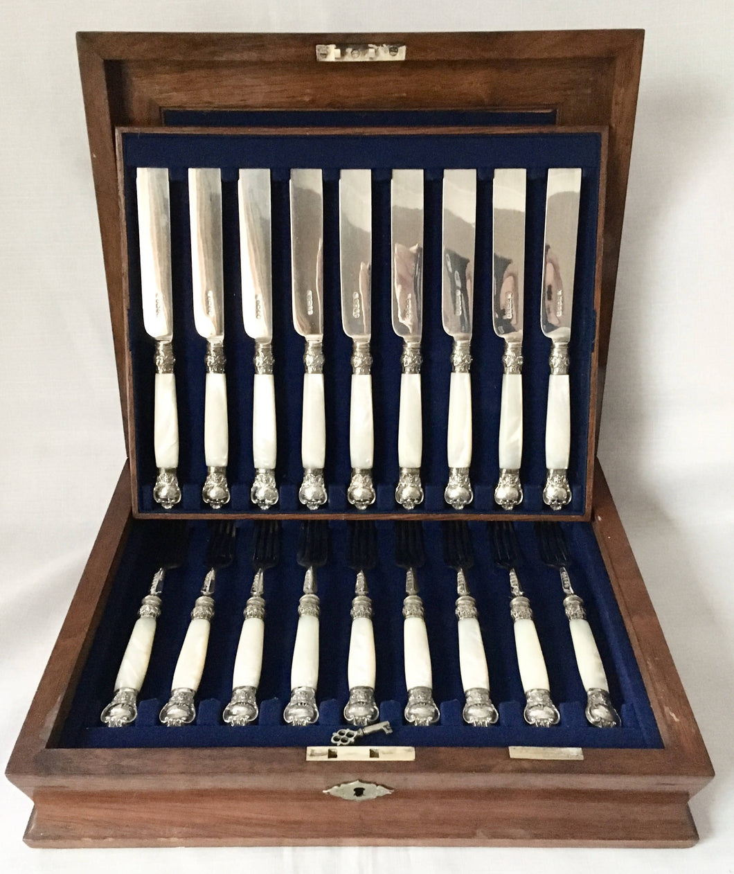Victorian silver and mother of pearl dessert knives and forks for nine. Sheffield 1870, Henry Wilkinson & Co.