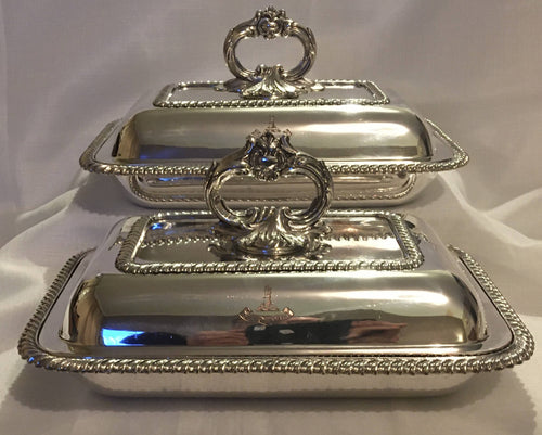 Pair of early Victorian, crested, silver plate on copper entree dishes.