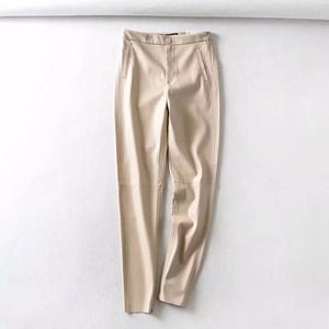 Milk faux leather trousers