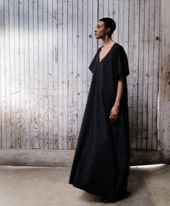 Minimalist maxi dress with deep v-neck and soft short sleeves. Dramatic A-Line.