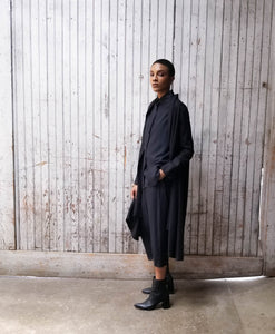 Oversized tunic with peter pant collar and button up front. High low tunic. Minimalism.